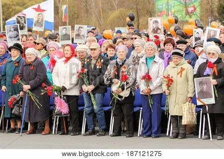 Kirishi, Russia - 9 May, Veterans of war and labor with flowers, 9 May, 2017. Holding a festive rally dedicated to the Victory Day.