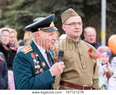 Kirishi, Russia - 9 May, A war veteran with a soldier, 9 May, 2017. Holding a festive rally dedicated to the Victory Day.