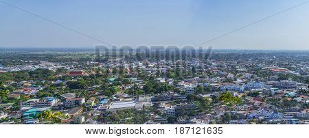Cityscape view from top of the hill or mountain with white cloud and blue sky view from top of Khao Sakae Krang mountain Uthai Thani province Thailand