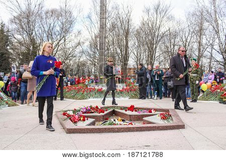Kirishi, Russia - 9 May, Officials with carnations at the eternal flame, 9 May, 2017. Laying wreaths and flowers in memory of the fallen at the Eternal Flame.