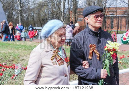 Kirishi, Russia - 9 May, A woman is a veteran with her son,9 May, 2017. Laying wreaths and flowers in memory of the fallen at the Eternal Flame.