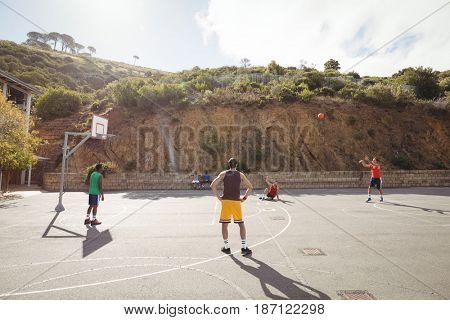 Basketball player taking a penalty shot in basketball court outdoors