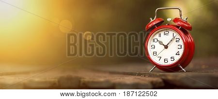 Time management concept - website banner of a vintage red alarm clock