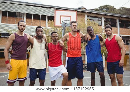 Portrait of basketball players standing in basketball court