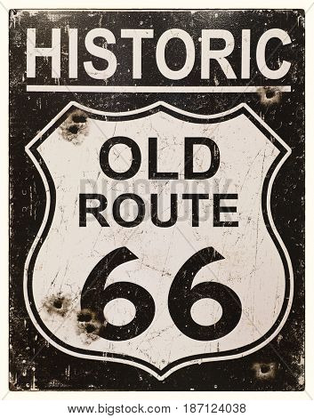 Sepia effect retro sign for the historic old Route 66 in America.  Faded, vintage style with bullet holes.