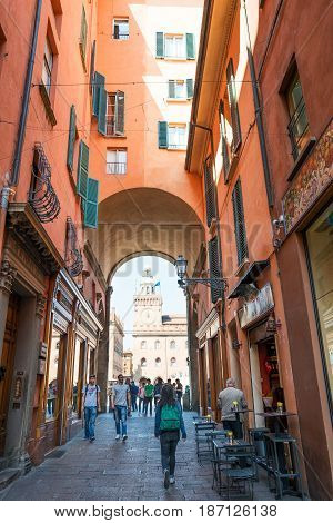 Bologna Italy - May 6 2016: Young people walking in Clavature street