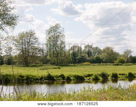 A River Running Through A Country Scene Outside In The Uk Essex Of England On A Summer's Day And Aft