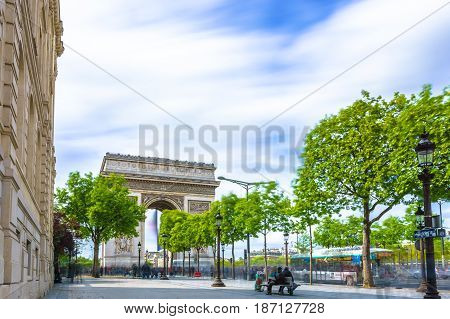 Paris France - May 1 2017: Long Exposure view of Champs-Élysées Avenue with Arc de Triomphe in a background on May 1 2017 in Paris France.