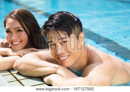 young Couple having fun in swimming pool