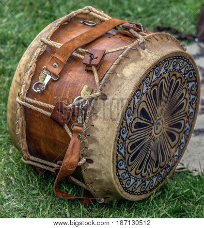 Ancient Dacian wooden and leather drum with decorations used in battles.