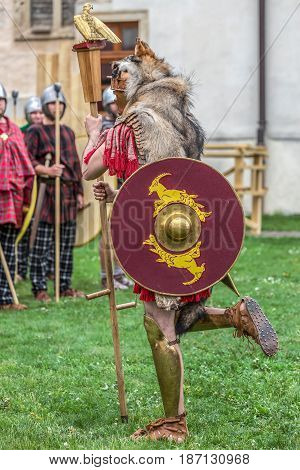 ALBA IULIA ROMANIA - APRIL 29 2017: Roman soldier in battle costume shows specific footwear. APULUM ROMAN FESTIVAL organized by the City Hall.
