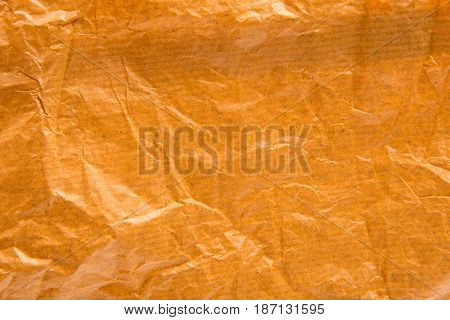 crumpled paper brown textured, wrinkled abstract background