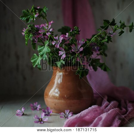 Pot with wildflowers. Wildflowers. Beautiful still life.