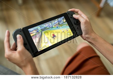 Hong Kong, 16 May 2017 -:Woman play with Nintendo Switch console at home