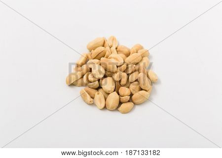 Fried Salted Peanuts On White Background. Snack.
