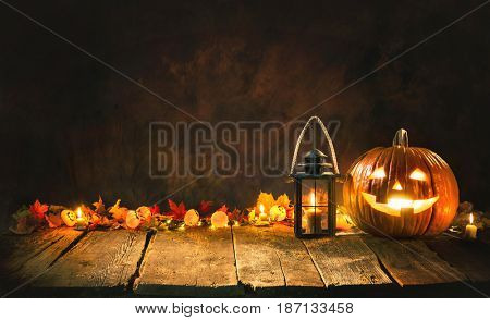 Halloween pumpkin head jack lantern on wooden board