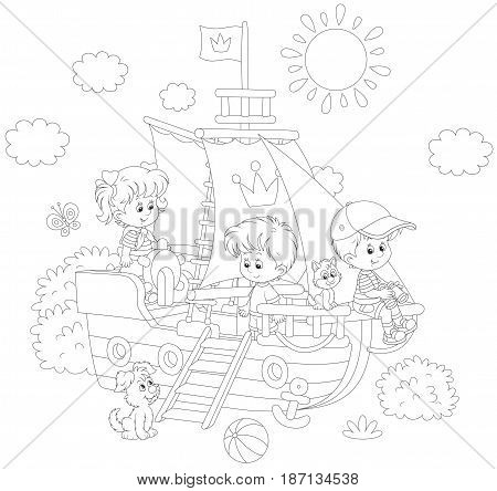 Little children playing on a toy sailing ship at a playground in a park