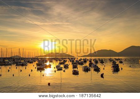 Sunset Above The Sea With Many Yachts