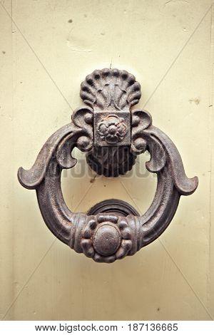Old metal round door knob. Architecture detail.