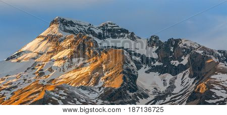 Winter sunset over the Grand Ferrand peak in Le Devoluy Massif in Hautes-Alpes France.