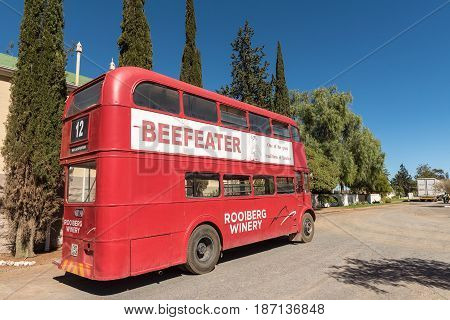 MATJIESFONTEIN SOUTH AFRICA - APRIL 2 2017: Historic double-decker bus at the Victorian village a national monument. Town built as refreshment stop on the Johannesburg to Cape Town railway