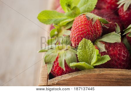 Freshly picked Strawberry's. In a wooden bowl ready to eat.