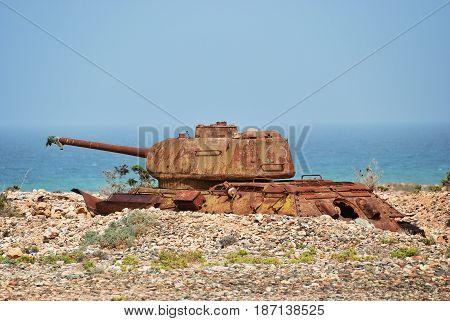 Rusty soviet battle tank on the shore of Indian ocean at the Socotra Island Yemen