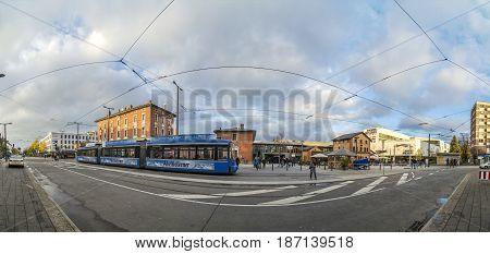 Skyline Of Munich Pasing Train Station And Street With People