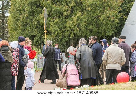 Kirishi, Russia - 9 May, Clergymen among the people, 9 May, 2017. Laying wreaths and flowers in memory of the fallen at the Eternal Flame.