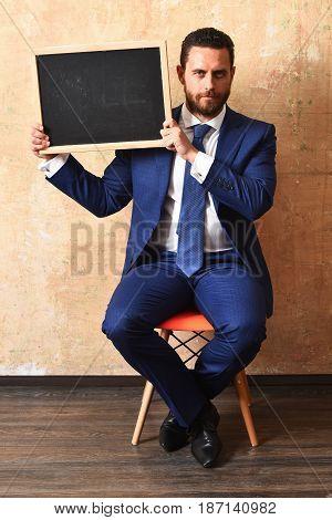 man and board. businessman holding a blackboard