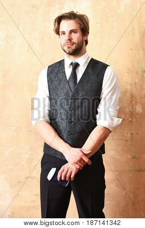 young bearded man or office worker in suit drink takeaway coffee or tea from plastic or paper cup