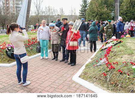 Kirishi, Russia - 9 May, People take pictures at the Eternal Flame, 9 May, 2017. Laying wreaths and flowers in memory of the fallen at the Eternal Flame.