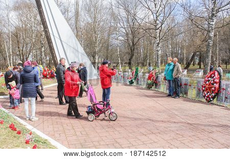 Kirishi, Russia - 9 May, People are photographed at the monument, 9 May, 2017. Laying wreaths and flowers in memory of the fallen at the Eternal Flame.