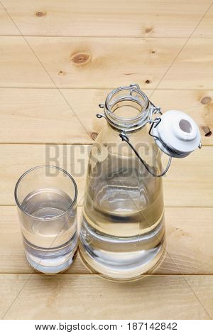 Water Jug and Glass with Wooden Background