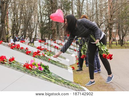 Kirishi, Russia - 9 May, Girls put roses on monuments, 9 May, 2017. Laying wreaths and flowers in memory of the fallen at the Eternal Flame.