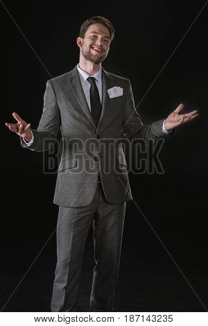 Happy Businessman With Joker Cards In Pocket Isolated On Black