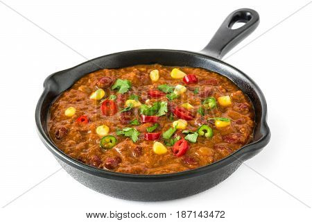 Traditional mexican tex mex chili con carne in a frying pan isolated on white background