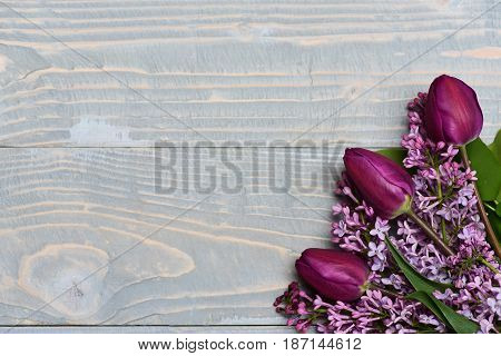 Anniversary Concept. Lilac Flowers With Tulips On Blue Vintage