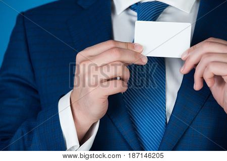 Man Holding White Business Card In Blue Formal Outfit
