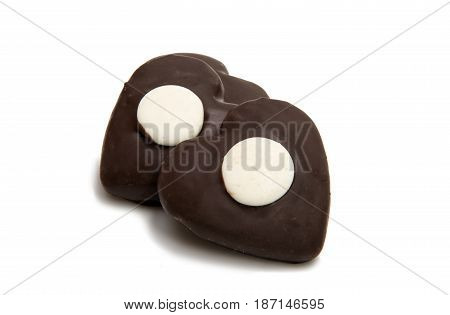 Cookie heart in chocolate isolated on white background