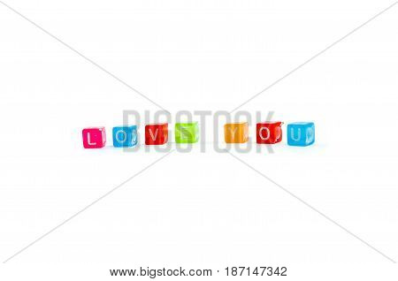Love word isolated on white background colourful small cubes. Declaration of love concept.