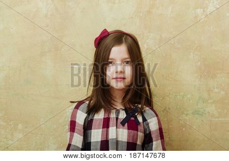 Adorable Girl With Headband And Red Bow In Long Hair
