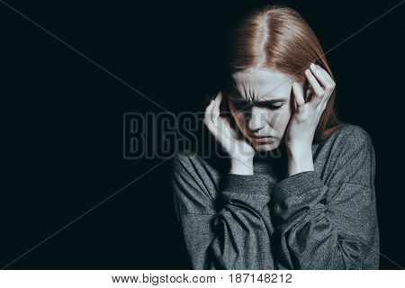Fearful Woman Covering Her Ears