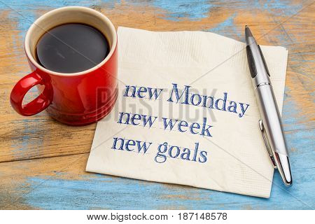 New Monday, new week, new goals - handwriting on a napkin with a cup of coffee