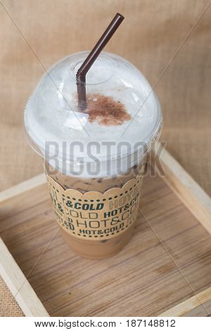 Close up ice coffee on wood table