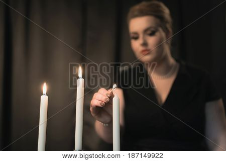 Retro 1950S Style Woman Lighting Candles For Supper.