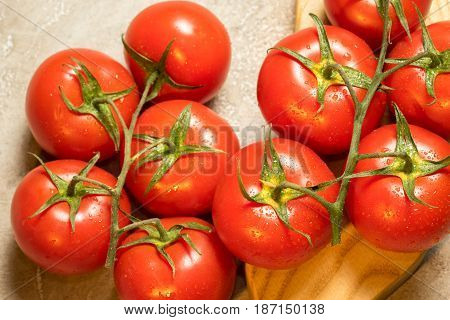 bunch of red ripe wet tomatoes close up top view
