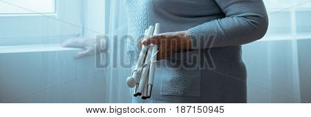 Woman With Parkinson's Holding Stick