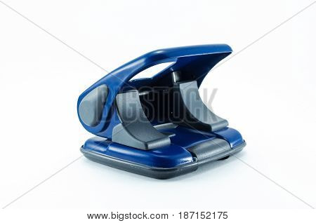 Hole puncher isolated on white background. Office accesories. Hole puncher side view.