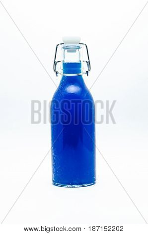 Bottle of blue drink  isolated on white background.
